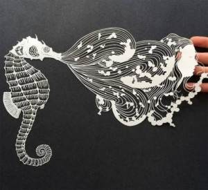 Carved paper figures by M. White