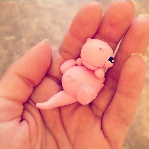 Tiny pink dinosaur