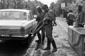 Dosimetrists check radiation levels in cars, leaving the city of Chernobyl