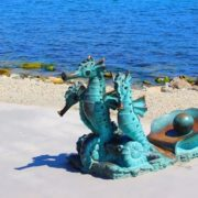 A bronze sculpture of three sea horses in Novorossiysk