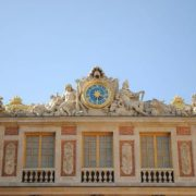 The facade of the palace. Clock of Louis XIV