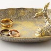 Saucer with floating koi carp