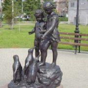 Monument Children Feeding Penguins in Omsk, Russia