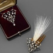 1890s pendant tassel transformation to large ornamental scrollwork accented with brilliant-cut diamonds