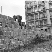 East Berlin cop is laying bricks. September 9, 1961
