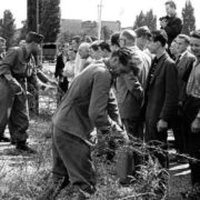 East German soldiers check barbed wire at the border, August 13, 1961