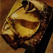 Riton in the form of a lion's head. Gold