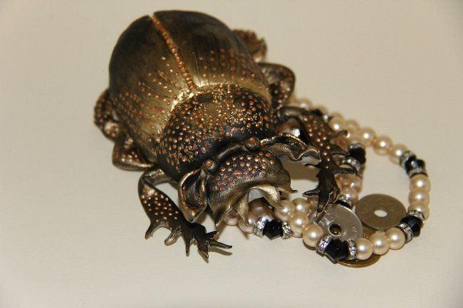 Charming scarab