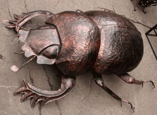 Monument to the Scarab beetle in Donetsk, Ukraine