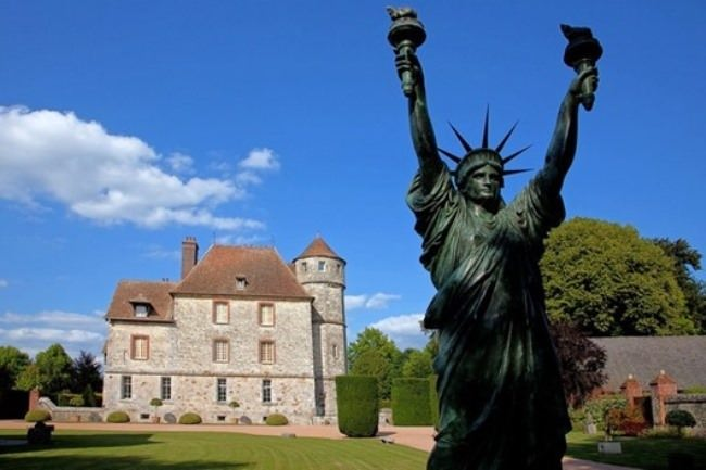The Statue of Liberty with two torches by Salvador Dali near the Castle of Vaskia in France