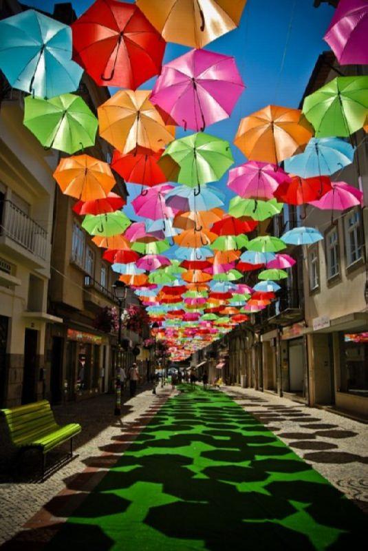 Umbrella Sky, installation of multi-colored umbrellas in Portugal