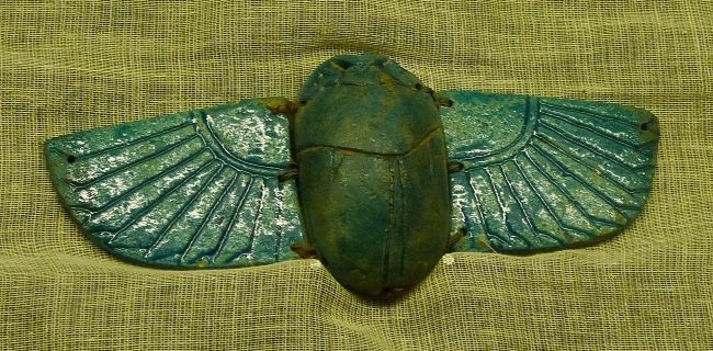 Winged scarab