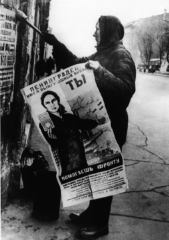 The woman pastes agitation posters in besieged Leningrad, 1943