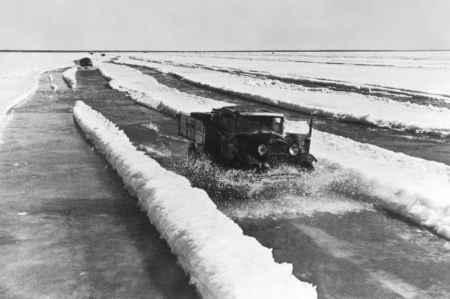 Trucks with food on the melted ice of Lake Ladoga in the spring of 1942