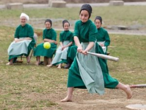 The girls are playing baseball