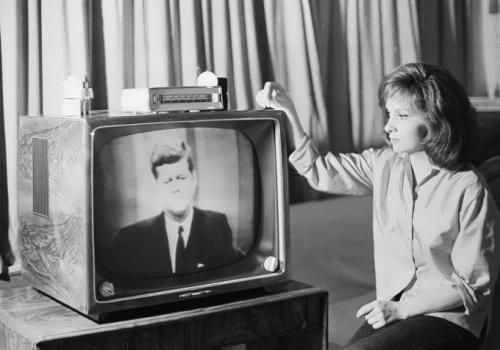 Gina Lollobrigida watches President Kennedy's speech at her villa in Rome on July 23, 1962
