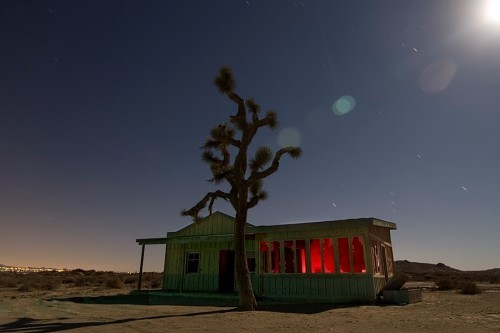 Abandoned roadside cafe on the background of which could be seen the lights of Los Angeles