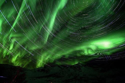 Northern Lights and star tracks in Norway. Photo by El Coleccionista de Instantes