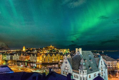 Northern lights in the city of Alesund, Norway. Photo Stian Rekdal