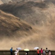 People with unbrellas standing on the embankment. standing on the dam The Yellow River Huang