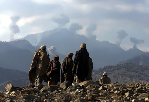 Afghan fighters of the antiterrorist coalition look at the bombing strikes of US aviation on the mountains of Tora Bora, 2001