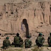 Afghan soldiers are sitting on a cliff above the Bamyan valley in central Afghanistan, September 22, 2005