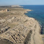 Ancient Sabratha on a background of modern buildings