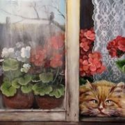Cat and geranium