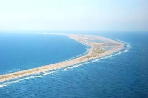 Crescent-shaped island