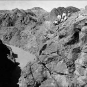 John Savage with a group of engineers studying the site of the construction of the Hoover Dam in the Black Canyon