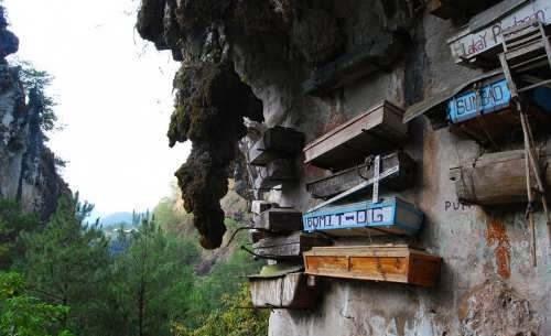 Wooden coffins hanging on the rocks