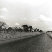 Accra. Akwapim hills. Asphalt road Accra-Somania running through savannah
