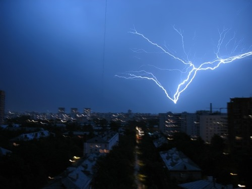 Lightning is striking directly into the base of the TV tower. On average, lightning hits the tower about 50 times a year