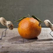 Peanuts and orange. Photo by Nailia Schwarz