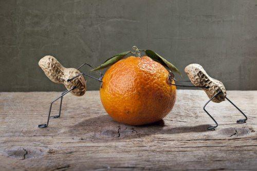 Peanuts and orange. Photo by Nailia Schwarz