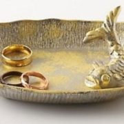 Saucer with floating koi carp