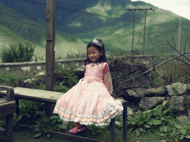 A girl is playing near her house in Paro, Bhutan. Bharat Sikka for TIME