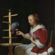 Frans van Mieris the Elder. A Woman in a Red Jacket feeding a Parrot
