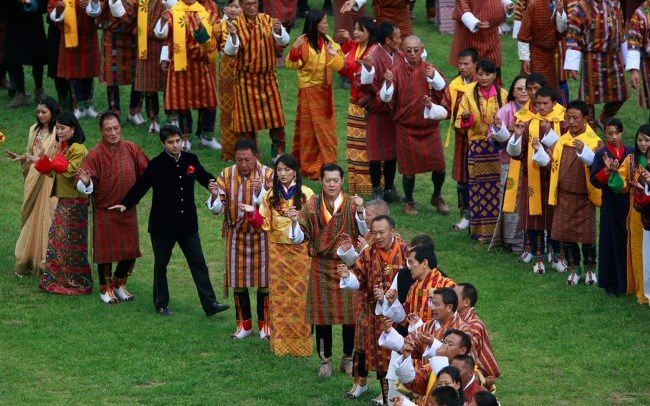 King and Queen of Bhutan are dancing the traditional final dance during the celebration of their wedding on October 15, 2011. AP Photo Kevin