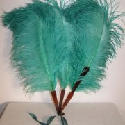 Antique Edwardian era green ostrich feather fan dates from 1910