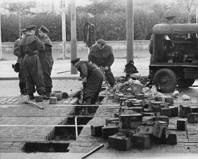 Soldiers are removing stones on Friedrichstrasse in East Berlin, August 13, 1961