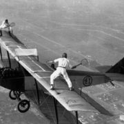 Daredevils Playing Tennis on a Biplane October 25, 1925