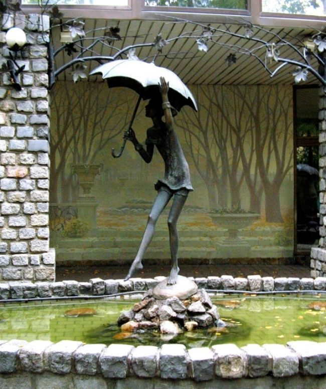 Fountain Girl with umbrella in Moscow, Russia
