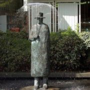 Fountain Man with umbrella in Lausanne, Switzerland