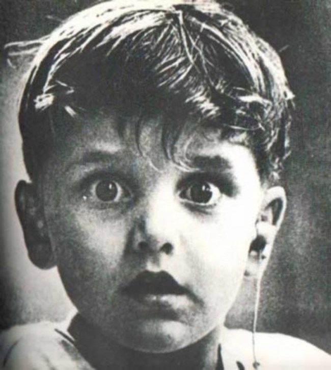 Harold Wittles hears for the first time in his life - the doctor has just installed his hearing aid