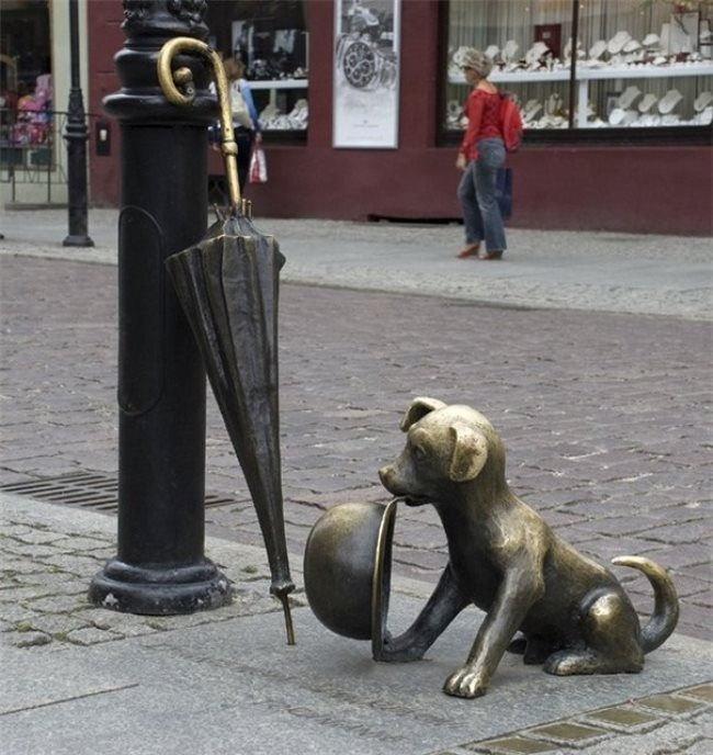 Monument to cartoonist Zbigniew Lengren in Torun, Poland