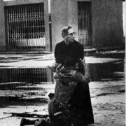 Priest Luis Padillo and a soldier injured by a sniper, during the uprising in Venezuela