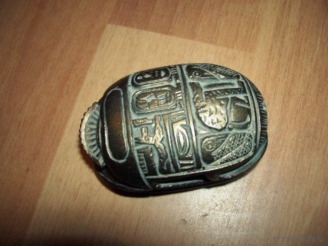 Talisman of a scarab beetle with protective symbols