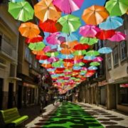 Umbrella Sky, installation of multi-colored umbrellas in Portugal