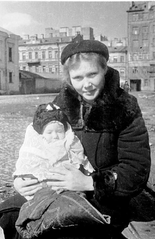 A resident of besieged Leningrad with her child